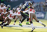 Seattle Seahawks  tight end Zach Miller (86) is wrapped up by Tampa Bay Buccaneers safety Mark Barron (23) after catching a 22-yard pass in the second quarter at CenturyLink Field in Seattle, Washington on  November 3, 2013.  The Seahawks beat the Buccaneers 27-24 in overtime.  ©2013. Jim Bryant. All Rights Reserved.