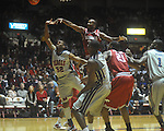 "Ole Miss guard Zach Graham (32) has his shot blocked by Arkansas' Marshawn Powell (33) at C.M. ""Tad"" Smith in Oxford, Miss. on Saturday, March 5, 2010. Mississippi won 84-74."