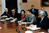 United States President Ronald Reagan makes a point during a meeting of the President's Foreign Intelligence Advisory Board on Thursday, March 12, 1987.  Seated, from left are: Albert Wohlstetter, Dr. Henry Kissinger; Chairperson Anne Armstrong; President Reagan; and Leo Charne..Mandatory Credit: Bill Fitz-Patrick - White House via CNP