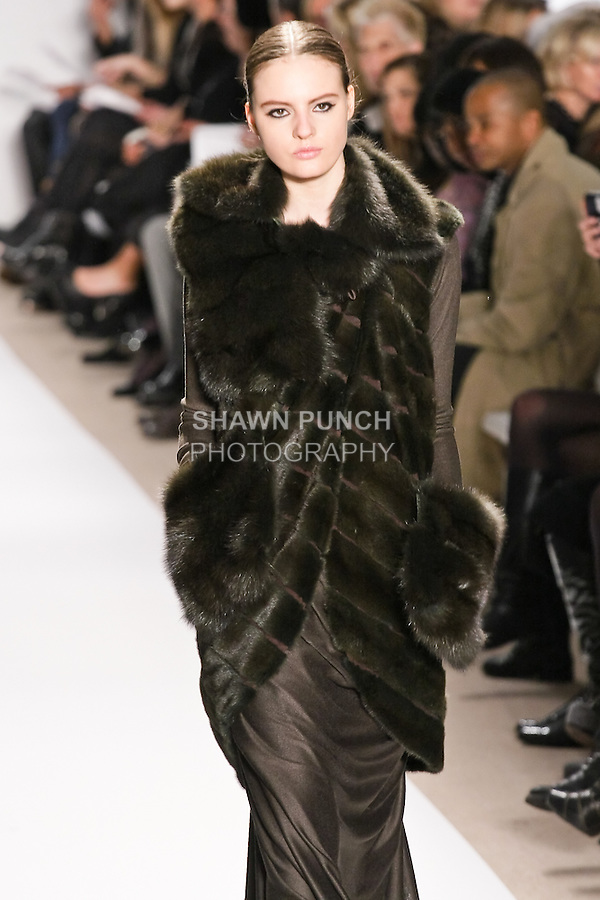 Tilda Lindstam walks the runway in an evergreen ermine and sable vest, and evergreen wool knit draped gown,  by Dennis Basso for his Dennis Basso Fall Winter 2010 collection fashion show, during Mercedes-Benz Fashion Week Fall 2010.
