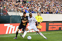 Sebastien Le Toux (9) of the Philadelphia Union and Julius James (2) of D. C. United battle for the ball. The Philadelphia Union defeated D. C. United 3-2 during a Major League Soccer (MLS) match at Lincoln Financial Field in Philadelphia, PA, on April 10, 2010.