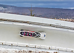 9 January 2016: Canadian pilot Chris Spring leads his 4-man team as they cruise through Curve 14 during their second run of the day at the BMW IBSF World Cup Bobsled Championships at the Olympic Sports Track in Lake Placid, New York, USA. Spring's team came in 12th for the day, with a 2-run combined time of 1:51.20. Mandatory Credit: Ed Wolfstein Photo *** RAW (NEF) Image File Available ***