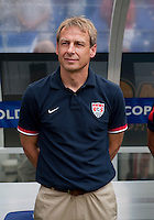 United States head coach Juergen Klinsmann watches his team before the quarterfinals of the CONCACAF Gold Cup at M&T Bank Stadium in Baltimore, MD.  The United States defeated El Salvador, 5-1.