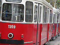 Image of red Vienna tram in motion.