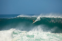"""WAIMEA BAY, Oahu/Hawaii (Tuesday, December 8, 2009) Kelly Slater (USA)- The Quiksilver In Memory of Eddie Aikau,  was officially  called """"ON"""" by Contest Director George Downing this morning. The ASP specialty sanctioned event kicked off at 8am with wave face heights in the 25-35-foot range..Nine times world champion Kelly Slater (USA) led for most of the day until Greg Long(USA) scored his best four scoring rides in the last heat of the day to over take Slater. Long scored a perfect 100 point wave late in the day to seal the first prize purse of $55,000. Slater was runner up with Sunny Garcia (HAW) in 3rd, defending champion Bruce Irons (HAW) 4th and Ramon Navarro (CHL)  in 5th place. Navarro won the Monster drop award for the biggest drop, also in the final heat of the day when wave faces were pushing 40' plus...The northern hemisphere winter months on the North Shore signal a concentration of surfing activity with some of the best surfers in the world taking advantage of swells originating in the stormy Northern Pacific. Notable North Shore spots include Waimea Bay, Off The Wall, Backdoor, Log Cabins, Rockpiles and Sunset Beach... Ehukai Beach is more  commonly known as Pipeline and is the most notable surfing spot on the North Shore. It is considered a prime spot for competitions due to its close proximity to the beach, giving spectators, judges, and photographers a great view...The North Shore is considered to be one the surfing world's must see locations and every December hosts three competitions, which make up the Triple Crown of Surfing. The three men's competitions are the Reef Hawaiian Pro at Haleiwa, the O'Neill World Cup of Surfing at Sunset Beach, and the Billabong Pipeline Masters. The three women's competitions are the Reef Hawaiian Pro at Haleiwa, the Gidget Pro at Sunset Beach, and the Billabong Pro on the neighboring island of Maui...Photo: Joliphotos.com"""