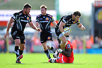 Luke Cowan-Dickie of Exeter Chiefs is tackled by Maro Itoje of Saracens. Aviva Premiership match, between Exeter Chiefs and Saracens on September 11, 2016 at Sandy Park in Exeter, England. Photo by: Patrick Khachfe / JMP