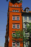 Narrow red apartment building in the centre of Munich.  Munich ,Bavaria, Germany.