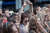 Fans watch Broken Social Scene play City Plaza during the Hopscotch Music Festival in Raleigh, N.C., Friday, Sept. 10, 2010.