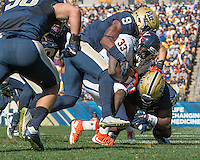 Pitt safety Jordan Whitehead (9) tackles Virginia running back Olamide Zaccheaus (33). The Pitt Panthers football team defeated the Virginia Cavaliers 26-19 on Saturday October 10, 2015 at Heinz Field, Pittsburgh, Pennsylvania.