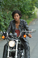 African American woman on a motorcycle