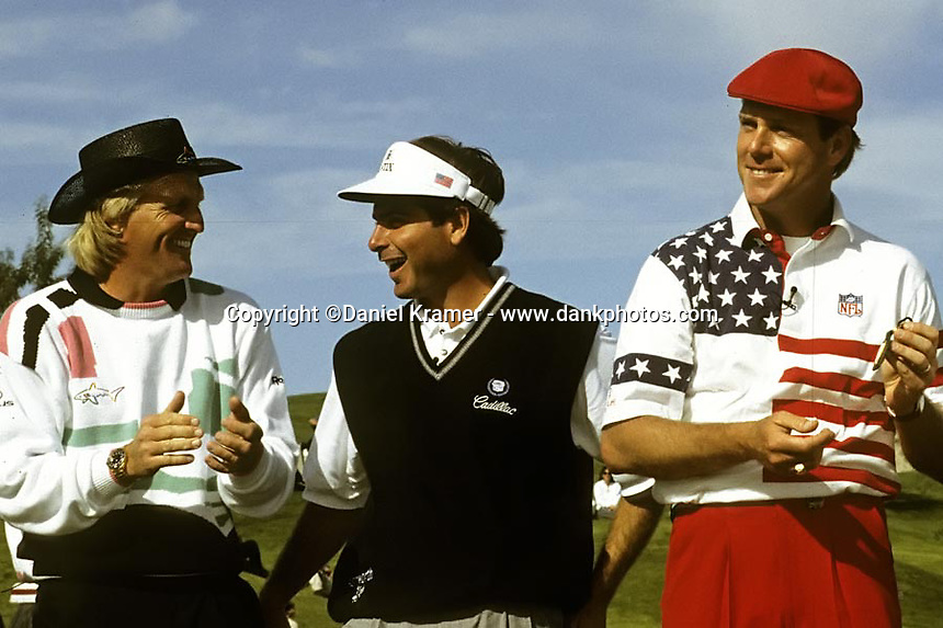 With Greg Norman and Fred Couples joking around, Oayne Stewart shows off one of the items he won at the 1992 Skins Game at Bighorn Golf Club in Palm Desert, Calif.