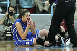 26 February 2012: Duke's Haley Peters holds blood in her hands from her mouth after suffering an injury near the end of the first half. The Duke University Blue Devils played the University of North Carolina Tar Heels at Carmichael Arena in Chapel Hill, North Carolina in an NCAA Division I Women's basketball game.