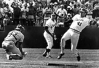 St. Louis Cardinal catcher Darrell Porter is late to tag <br />San Francisco Giants Darrell Evans who scored the winning run...coach is Jim Davenport. (1982 photo by Ron Riesterer)