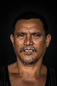 44 year old Tuna fisherman, Jimmy Pilapil poses for a portrait at the Casa, the Tuna buying house in Puerto Princesa, Palawan in the Philippines. <br /> Photo: Sanjit Das/Panos for Greenpeace