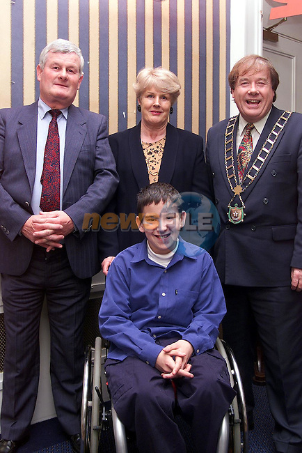 Michael and Doris Casey from Platin Road with Owen Mullen, The Priory and Mayor Frank Godfrey at the Wheelchair Association Dinner Dance in the Europa Hotel..Picture: Paul Mohan/Newsfile