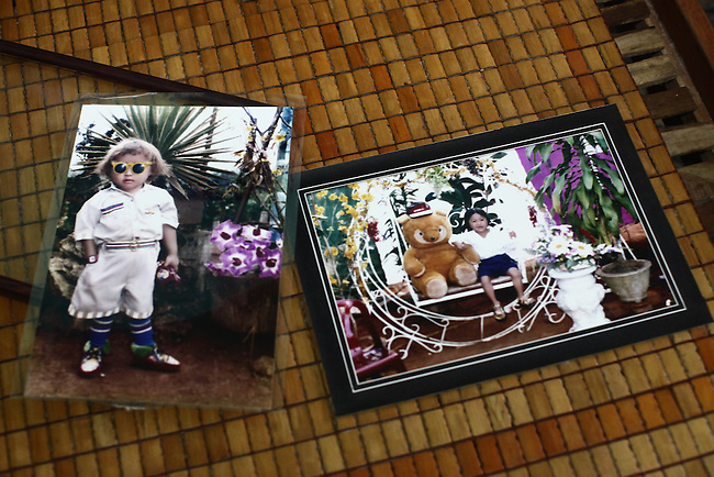 Photographs show La Thanh Toan (left) and La Thanh Nghia (right) as children at their home near Da Nang, Vietnam. The two brothers, now 21 and 18, are third generation victims of dioxin exposure, the result of the U.S. military's use of Agent Orange and other herbicides during the Vietnam War more than 40 years ago. The brothers were born healthy, but began to suffer from muscular dystrophy and other problems as they grew older. They are now confined at home as their bodies and lives waste away. The Vietnam Red Cross estimates that 3 million Vietnamese suffer from illnesses related to dioxin exposure, including at least 150,000 people born with severe birth defects since the end of the war. The U.S. government is paying to clean up dioxin-contaminated soil at the Da Nang airport, which served as a major U.S. base during the conflict. But the U.S. government still denies that dioxin is to blame for widespread health problems in Vietnam and has never provided any money specifically to help the country's Agent Orange victims. Jan. 9, 2013.
