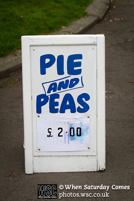 Ramsbottom United 1 Barwell 3, 03/10/2015. Riverside Stadium, Northern Premier League. A sign advertising pie and peas inside the Harry Williams Riverside Stadium, home to Ramsbottom United before they played Barwell in a Northern Premier League premier division match. This was the club's 13th league game of the season and they were still to record their first victory following a 3-1 defeat, watched by a crowd of 176. Rams bottom United were formed by Harry Williams, the current chairman, in 1966 and progressed from local amateur football  in Bury to the semi-professional leagues. Photo by Colin McPherson.