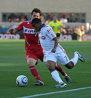 Toronto forward Joao Plata (7) attempts to dribble past Chicago defender Dan Gargan (3).  The Chicago Fire defeated Toronto FC 2-0 at Toyota Park in Bridgeview, IL on August 21, 2011.