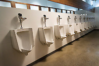 A long line of urinals awaits a multitude of men in a large restroom in Brooklyn in New York on Sunday, January 17, 2016 . (© Richard B. Levine)