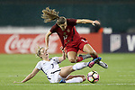 WASHINGTON, DC - MARCH 07: Tobin Heath (USA) (17) is fouled by Sandie Toletti (FRA) (7). The United States Women's National Team hosted the France Women's National Team as part of the SheBelieves Cup on March 7, 2017, at RFK Stadium in Washington, DC. France won the game 3-0.