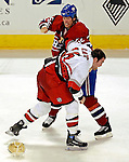 6 February 2007: Montreal Canadiens defenseman Craig Rivet (52) fights with Carolina Hurricanes left wing forward Andrew Ladd at the Bell Centre in Montreal, Canada. Both players received five-minute penalties for fighting. The Hurricanes defeated the Canadiens 2-1....Mandatory Photo Credit: Ed Wolfstein *** Editorial Sales through Icon Sports Media *** www.iconsportsmedia.com