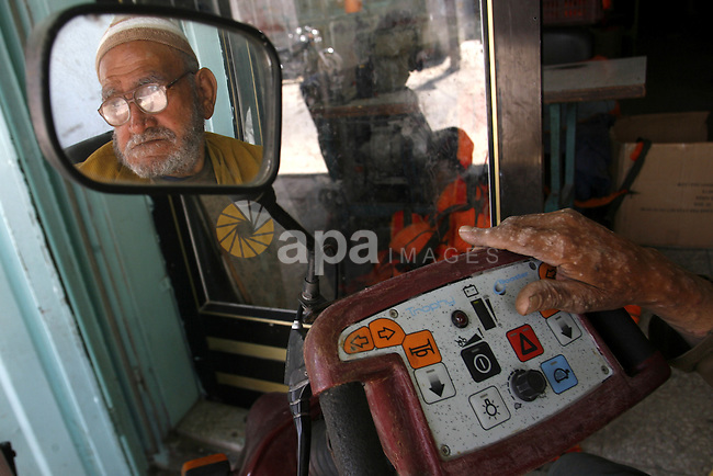 A Palestinian man fixes a generator at a shop in Rafah in the southern Gaza Strip, on June 04, 2012. The people of the Gaza Strip use a large number of generators because of the continuing lack of electricity in the Gaza Strip. Photo by Eyad Al Baba