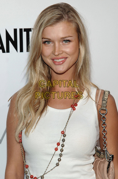 JOANNA KRUPA.At The opening party for the BCBG Max Azria flagship store, Rodeo Drive,.Beverly Hills, 18th August 2005.portrait headshot white top red beads pink handbag silver chain eye contact.www.capitalpictures.com.sales@capitalpictures.com.© Capital Pictures.