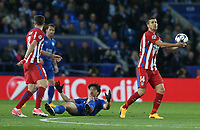 Leicester City's Shinji Okazaki is bundled over by Atletico Madrid's Saul Niguez (left) and Gabi (right)<br /> <br /> Photographer Stephen White/CameraSport<br /> <br /> UEFA Champions League Quarter Final Second Leg - Leicester City v Atletico Madrid - Tuesday 18th April 2017 - King Power Stadium - Leicester <br />  <br /> World Copyright &copy; 2017 CameraSport. All rights reserved. 43 Linden Ave. Countesthorpe. Leicester. England. LE8 5PG - Tel: +44 (0) 116 277 4147 - admin@camerasport.com - www.camerasport.com