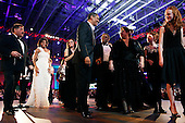Washington, DC - January 20, 2009 -- United States President Barack Obama (C) and First Lady Michelle Obama (L) attend the Neighborhood Inaugural Ball at the Washington Convention Center on January 20, 2009 in Washington, DC. Obama became the first African-American to be elected to the office of President in the history of the United States. .Credit: Chip Somodevilla - Pool via CNP