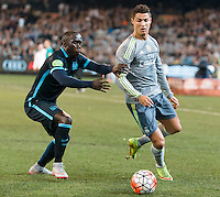 Melbourne, 24 July 2015 - Bacary Sagna of Manchester City and Cristiano Ronaldo of Real Madrid compete for the ball in game three of the International Champions Cup match between Manchester City and Real Madrid at the Melbourne Cricket Ground, Australia. Real Madrid def City 4-1. (Photo Sydney Low / AsteriskImages.com)