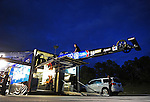 Jan. 16, 2012; Jupiter, FL, USA: Crew members load the car of NHRA top fuel dragster driver Antron Brown into the hauler during testing at the PRO Winter Warmup at Palm Beach International Raceway. Mandatory Credit: Mark J. Rebilas-