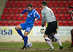 St Johnstone v Aberdeen....02.03.11 .Peter MacDonald tries a cheeky back heel against Jamie Langfield.Picture by Graeme Hart..Copyright Perthshire Picture Agency.Tel: 01738 623350  Mobile: 07990 594431