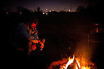 Gabriel Gomez, a former elder of SafeGround, but was exiled, sits by a fire near the SafeGround camp in Sacramento, Calif., January 14, 2011.