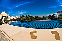 Foot prints on the warm sandstone of the poolside room at the Oberoi Udaivilas.<br /> (Photo by Matt Considine - Images of Asia Collection)