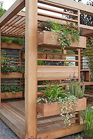 Covered Deck with windowbox container garden is a creative use of backyard space and landscaping idea for vertical space