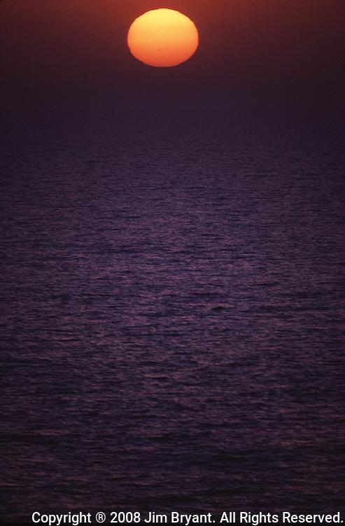 Sunset in Arabian Gulf off the coast of Bahrain. (Jim Bryant Photo).....