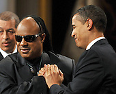 "Washington, D.C. - February 25, 2009 -- United States President Barack Obama shakes hands with Stevie Wonder as he and first lady Michelle Obama host ""Stevie Wonder In Performance at the White House: The Library of Congress Gershwin Prize"" to showcase an evening of celebration at the White House in honor of musician Stevie Wonder's receipt of the Library of Congress Gershwin Prize for Popular Song in the East Room of the White House in Washington, D.C. on Wednesday, February 25, 2009..Credit: Ron Sachs / Pool via CNP"