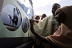 A patient at the Kwali Rehabilitaion Center takes her turn leaving her own five-fingered marks on a van donated by singer Natalie Imbruglia. The van will be used to transport patients to and from the hospital and their communities. The women at the center are recovering from surgery to eliminate a condition known as fistula and waiting to be returned and re-integrated to their home communities. The center also tries to teach them basic skills such as literacy and knitting and sewing. Imbruglia and UNFPA, the United Nations Population Fund, are working to bring awareness to obstetric fistula, a devastating injury of childbirth that affects more than two million women in developing countries, particularly Nigeria where half of known cases are found. The condition, caused by damage to the walls of the vagina during protracted labor, usually leads to the death of the child and leaves affected women incontinent and often disowned by their husbands and communities.