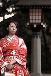 A kimono-clad woman waits for her friends after attending a ceremony held for Coming-of-Age Day in Tokyo, Japan. While Japanese women can marry as early as 16 years of age and men at 18, neither is considered to reach adulthood until they reach 20, when they can also legally begin to smoke, drink and vote.ey can also legally begin to smoke, drink and vote.