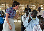 Sister Sandra Amado, a Comboni sister from Brazil, emphasizes pronunciation as she teaches a class in a teacher training course in Agok, a town in the contested border region of Abyei between Sudan and South Sudan. Sister Amado is a volunteer with Solidarity with South Sudan, an international network of Catholic groups providing training for teachers, health care workers, and pastoral agents in South Sudan. The teachers she is teaching in Agok are among tens of thousands of people displaced in 2011 attacks by soldiers and militias from the northern Republic of Sudan.