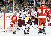Kieran Millan (BU - 31), Patrick Brown (BC - 23), Bill Arnold (BC - 24), Corey Trivino (BU - 10) - The Boston College Eagles defeated the Boston University Terriers 3-2 (OT) in their Beanpot opener on Monday, February 7, 2011, at TD Garden in Boston, Massachusetts.