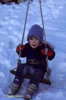 FA18-013z  Child swinging in snow, winter