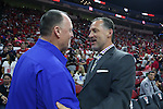 03 November 2016: NC State head coach Mark Gottfried (right) and Lynn head coach Jeff Price (left) meet before the game. The North Carolina State University Wolfpack hosted the Lynn University Fighting Knights at PNC Arena in Raleigh, North Carolina in a 2016-17 NCAA Division I Men's Basketball exhibition game. NC State won the game 100-66.