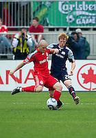 22 May 2010: New England Revolution defender Pat Phelan #28 Toronto FC forward Chad Barrett #19 in action during a game between the New England Revolution and Toronto FC at BMO Field in Toronto..Toronto FC won 1-0.....