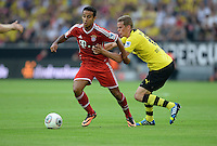 FUSSBALL   1. BUNDESLIGA   SAISON 2013/2014   SUPERCUP Borussia Dortmund - FC Bayern Muenchen           27.07.2013 Thiago Alcantara (li, FC Bayern Muenchen) gegen Sven Bender (re, Borussia Dortmund)