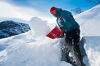 Saltoluokta Mountain Station, Jokkmokk, Lapland, Sweden, March 2013. building a snow shelter is vital for survival in cold scandinavian winter. Arctic survival training and winter bushcraft  in the frigid mountains of the Stora Sjofallet National Park and Sarek National Park with mountain guide Claes Jorgen Pohl.  Photo by Frits Meyst/Adventure4ever.com