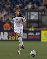 Philadelphia Union midfielder Brian Carroll (7) passes the ball. In a Major League Soccer (MLS) match, the Philadelphia Union defeated the New England Revolution, 3-0, at Gillette Stadium on July 17, 2011.