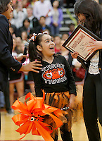 "NWA Democrat-Gazette/DAVID GOTTSCHALK   Andrea ""Isa"" Perez, a first grade student from Tyson Elementary School, is surprised Friday, November 6, 2015,when she receives a trip to Disney World during a special event pep rally at Springdale High School. Isa received the trip through the Make A Wish Foundation Mid-South Chapter with funds raised by the student organization DECA at the High School."