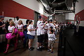 Houston, Texas<br /> October 2, 2011<br /> <br /> Fans, waiting outside the team's locker-room cheerleaders walk the hallways of the stadium. <br /> <br /> The Houston Texans defeated the Pittsburgh Steelers at the Reliant Stadium 17 to 10.