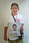 Tomasa Guzman holds a photo of her son Deibis Paz Guzman during a vigil in Tapachula, Mexico, on December 17, 2013. The Honduran woman was part of a group of Central Americans who came to Mexico in search of family members who disappeared there, many while on their way north to the United States. The group, mostly mothers looking for their children, spent 17 days touring 14 Mexican states in search of their loved ones.<br /> <br /> Guzman says her son migrated north in 2011, and last called him from Guadalajara, Mexico. She hasn't heard from him since.